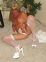 A crossdresser posing in heels and stockings gelery